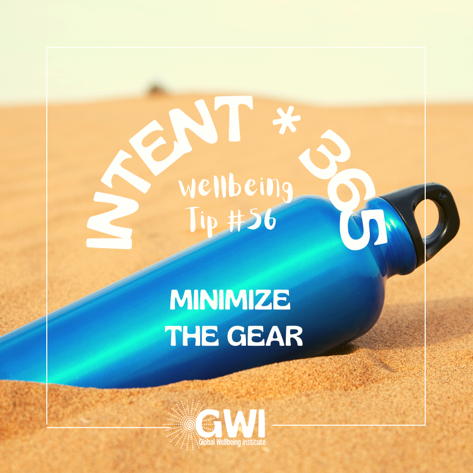 minimize the gear (blue metal water bottle in the sand)