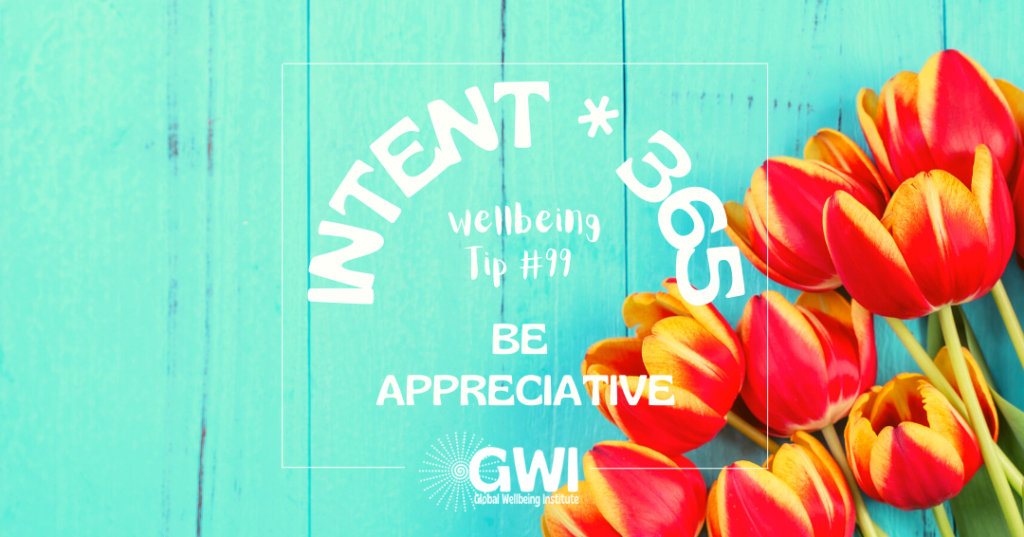 wellbeing tip 99: be appreciative (red tulips on aqua background)